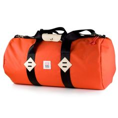 Orange Duffel from Topo Designs  When you need to carry more, you need the Topo Duffel. Made from ultra durable 1000d Cordura it'll stand up to the abuse of airport baggage handlers, Central American cabbies, and whatever else you want to throw at it. Simple on the outside, beautifully lined with coated nylon pack cloth on the inside. Comes with a detachable shoulder strap, inside zipped pockets and a durable leather handle.