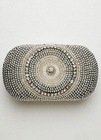 "Rock this ultra-glam minaudiere handbag as you step out in town!  Solid satin back. Clasp closure.  Length: 5.5"". Height: 4"". Drop in chain: 42"".  Fully lined. Imported. $69.50"