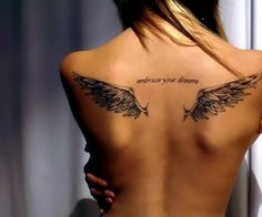 Angel wings on back with script