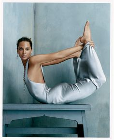 Now THAT is a stylish bow pose... Christy Turlington - mother, model, activist