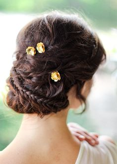 gold flower pins with an updo.
