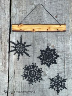 This decoration is made of birch wood and crocheted snowflakes.