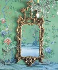 Wallpaper and Chinese Chippendale style mirror