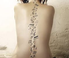 music notes tattoo...love...but that would hurt!!