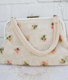Vintage beaded bag with embroidered flowers