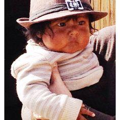 Indian baby in Uros, lake Titicaca, Peru