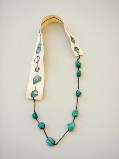 Necklace |  Hsiu -Hsuan Huang. Turquoise, canvas, oil paint.