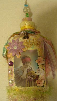 altered art bottle on etsy