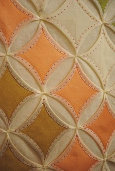 Hand quilted Cathedral Windows