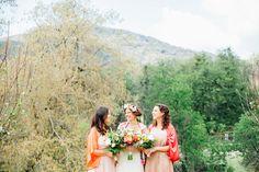 Bridesmaids wearing pastels + bright kimonos