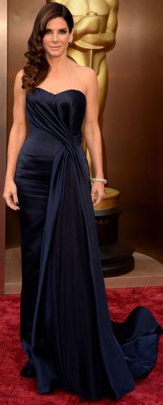Sandra Bullock in an elegant blue Alexander McQueen gown on the red carpet at the 2014 Oscars. #AcademyAwards #Oscars #2014 #SandraBullock #BestDressed