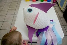 This blogger used this cute fish for Hungry Fish Addition, but all sorts of treats and goodies can be fed to this fish! Start with a white cocoon paper lantern from http://www.partylights.com/Lanterns/Cocoon.