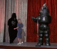 Gorilla Dances with Lady While Robot Claps