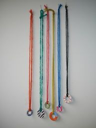 craft for older kids - necklaces made with washers and yarn and decorated with nailpolish. via the handmade adventures of captain crafty.