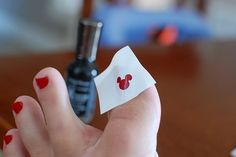 Stencil pictures on your toes- an inexpensive 'treat' for your girls on your next Disney trip!