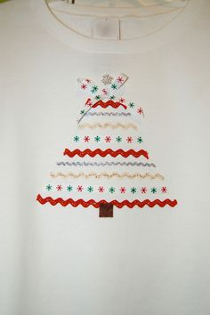 "My ""ribbon"" Christmas tree on a sweatshirt for my sister."