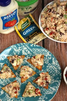 Greek Chicken Salad on Pita Chips -- This delicious appetizer is perfect for you next summer party! Recipe and photo by blogger, Jess Gonzalez, of www.onsugarmountain.com.