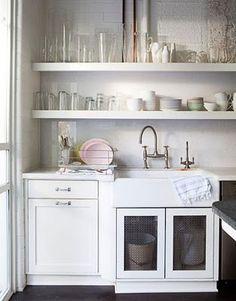 i have come to love open shelving and always a farmhouse sink.