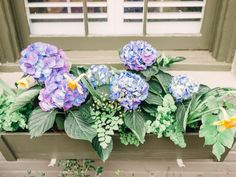 A simple way to bring in less permanent color is by adding window boxes.  I painted these the same color as the door and window trim for consistency and to allow the gorgeous floral colors to shine through--> http://hg.tv/y8qd