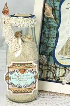 Keepsake Memory Bottle of sand and shells designed by Sharon Harnist.