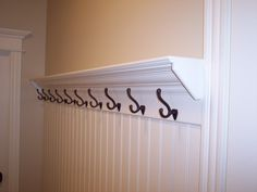 Hooks in mudroom at the top of bead board wall