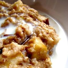 Place 2 sliced apples, 1/4 cup brown sugar, 1 tsp cinnamon, pinch salt in the bottom of the crock pot.  Pour in 2 cups of oatmeal, 2 cups of milk and 2 cups water.  Do NOT stir.  Cook overnight for 8 - 9 hours on low.