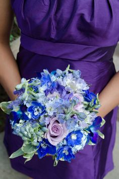 Bouquet of purple roses with blue Hydrangeas and wild flowers