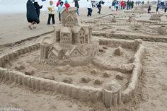 sand castle building at cannon beach oregon