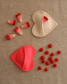 Molly's Sketchbook: Felt Candy Hearts. A homey, straight-from-the-heart kind of Valentine gift are made with these hand stitched little Felt Candy Hearts. They're great for storing candy, notes and trinkets and are truly as easy as pie to sew.