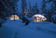 the glass igloo village in kakslauttanen, finland- for magnificent views of the northern lights.