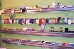 gutter ribbon holder...clever! I would totally put this in a craft room.