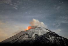 A cloud of ash belches out of Mexico's Popocatepetl volcano, some 35-mi from Mexico City, as seen from Paso de Cortes, MX state of Puebla on 5/20/2013. (Arturo Andrade/APF/Getty Images