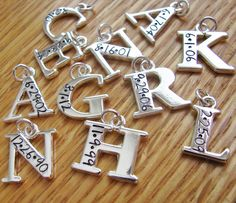 initial charm hand stamped with birth date of children (charm only)...Great for Mother's Day.