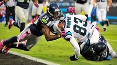 Seattle defenders Brandon Browner, left, and Marcus Trufant, right, tackle Carolina wide receiver Louis Murphy just short of the goal line late in the fourth quarter. The Seahawks beat the Panthers, 16-12.