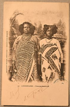 another portrait of Queen Binao of the Sakalava kingdom of Madagascar, who reigned 1895-1927, with an attendant. Photo around 1904.