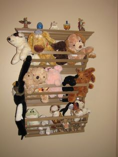 Magazine rack spray painted and transformed into a stuffed animal holder