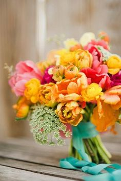 I like the blue ribbon and the yellow/orangey flowers, would like to implement this in one of the other bouquets I already love somehow.