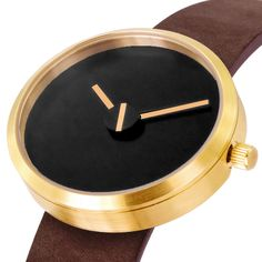 Sometimes watch in brass with brown strap designed by Denis Guidone for Projects. Available at Dezeen Watch Store: www.dezeenwatchstore.com #watches