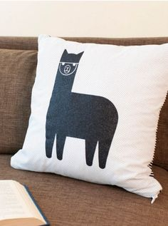 Add a fun and funky accent pillow to your home decor with this easy Alpaca Pillow tutorial.