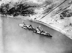 German light cruiser SMS Konigsberg, scuttled in the Rufiji delta of what is now Tanzania after bombardment by British shallow draft Monitors HMS Severn and HMS Mersey in July 1915. Her 4.1 in guns have already been removed by her crew in this photo, and served on in the East African campaign.