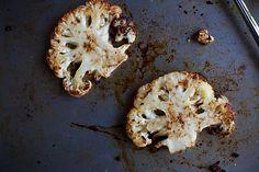 cauliflower steak on a baking sheet cauliflow steak