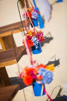 Colorful floral aisle markers at a beach Mexican destination wedding! {Dino Gomez}