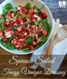 This simple spinach summer salad can be eaten as a side or throw a grilled chicken breast on top or some tuna and you have a meal! For this recipe and more, visit HeandSheEatClean.com #summer #salad #strawberries #spinach #dressing #vinegar