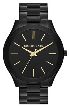 This Sleek Michael Kors Watch would make an incredible addition to arm candy in your black and white style!
