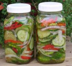 Cucumber Salad lesleycooks.com/canning/cathyscucumbersalad  7-c unpeeled cucumbers sliced thin (about 7 large)  1-c sliced onions  1-cup sliced green peppers  1-tbsp salt  1-cup white vinegar  2-cups sugar  1-tsp celery seed  1-tsp mustard seed  Mix cucumbers, onions, peppers and salt; Put vinegar, sugar, celery seed and mustard seed in a pot,  bring to a boil, let cool for one hour  Pour over cucumbers  Put in jars and store in refrigerator up to 2 months  Makes 2 quart