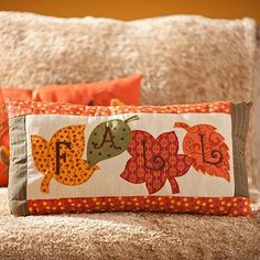 Festive pillows make great decor accents! Our Fall Patchwork Accent Pillow is patch worked with orange and green linen and embroidered in a chocolate brown. #kirklands #harvest