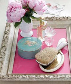 This is so genius. Repurpose an old frame as a vanity tray, place a sheet of colored paper under the glass and put all your pretty things on top. Doing this.