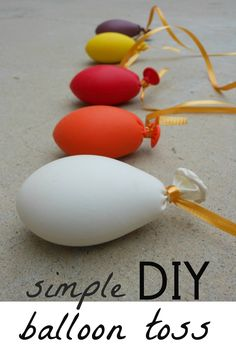 DIY balloon toss with rice filled balloons.  Suggested ages 2 - 6. It almost like another great game, Tiki Toss! Playtikitoss.com #fungames #outdoorgames #bbqgames #indoorgames #drinkinggames #greatideas #parentscanhavefuntoo #fununderthesun #family #ocean #beach #kidgames #game #beautifulday #summer #spring #DIYgames
