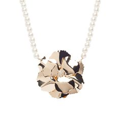 I love the Lolita Jewelry Pearl Corsage Flower Necklace from LittleBlackBag