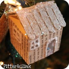 Popsicle and cardboard cottage ornament.